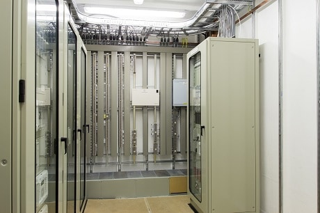 Packaged substation internal view showing protection panels and primary marshalling field